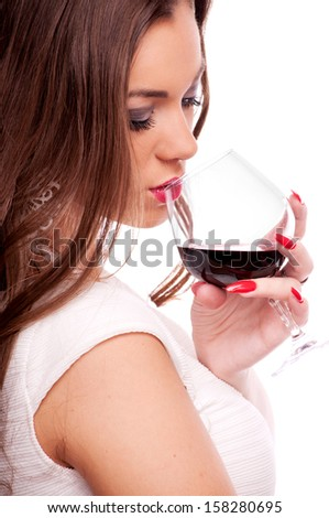 Beautiful brunette with curly hair drinking red wine, isolated on white - stock photo