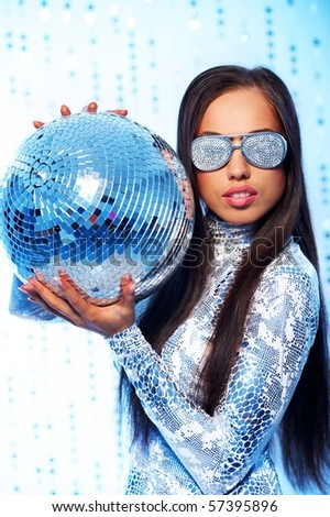 Beautiful brunette with disco ball - stock photo