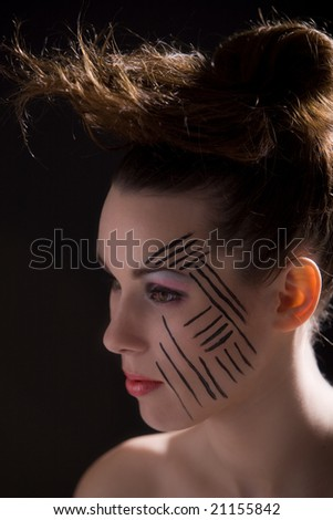 Beautiful brunette with extreme makeup and wild hairstyle