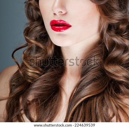beautiful brunette with gorgeous curly hair. red lipstick - stock photo