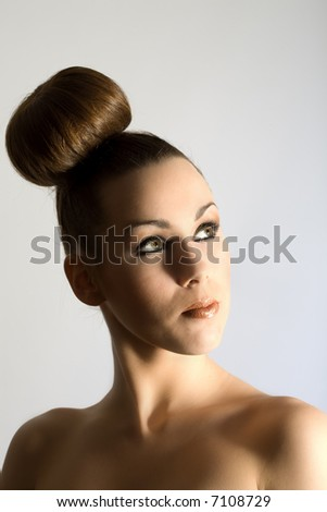 Beautiful brunette with hair in fashionable style - stock photo