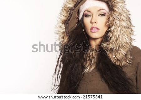 beautiful brunette with hat posing on white background