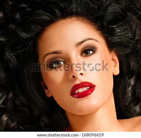 beautiful brunette with long  curly hair - stock photo