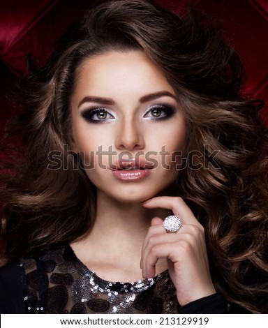 Beautiful brunette with long curly hair.  - stock photo