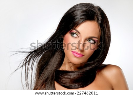 Beautiful brunette with long hair - stock photo