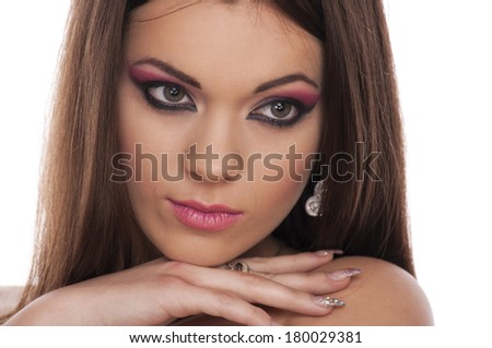 Beautiful brunette with makeup - stock photo