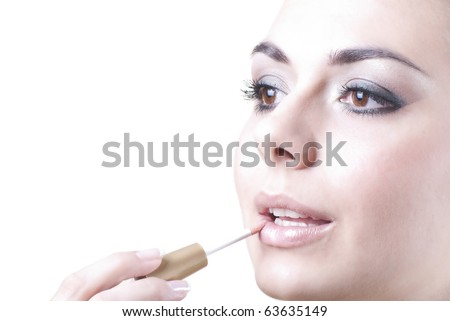 Beautiful brunette with makeup lip gloss isolated on white - stock photo