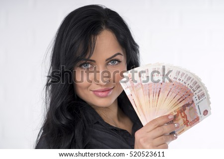 Beautiful brunette with money in hand