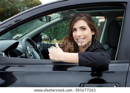 beautiful brunette with new car smiling happy - stock photo