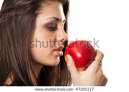 Beautiful brunette with red apple isolated on white background