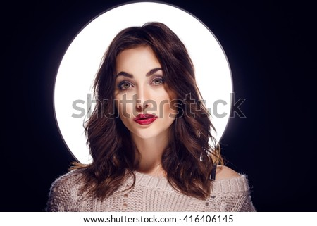 Beautiful brunette with red lips  - stock photo