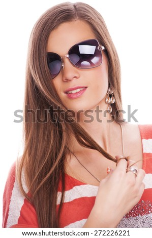 Beautiful brunette with sunglasses playing with her hair, isolated on white - stock photo