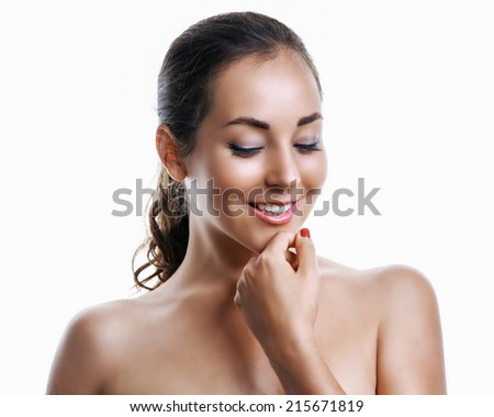beautiful brunette woman applying face cream, isolated on white studio background - stock photo