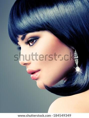 Beautiful Brunette Woman. Bob Haircut. Fringe Hairstyle. Short hair. Fashion Model Girl with beauty diamond earrings. Perfect Makeup. Make up  - stock photo