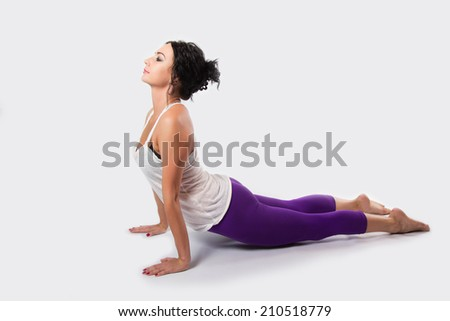 Beautiful brunette woman doing yoga, stretching, relaxation. indoors - stock photo