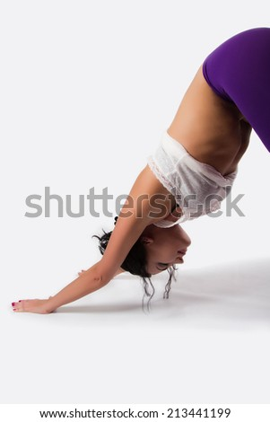Beautiful brunette woman doing yoga, stretching, relaxation. indoors,  - stock photo