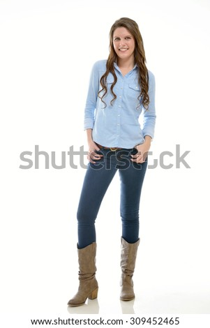 Beautiful brunette woman - dressed in country and western attire - in studio - stock photo