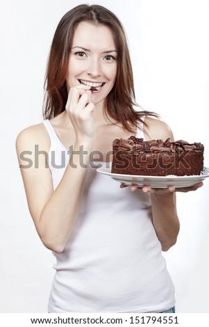beautiful brunette woman eating chocolate cake - stock photo