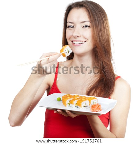 beautiful brunette woman eating sushi