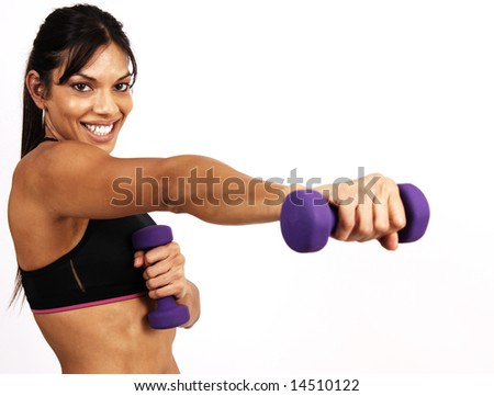 Beautiful brunette woman exercising with purple dumbbells