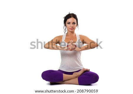 beautiful brunette woman in a lotus position, yoga, isolation on white - stock photo