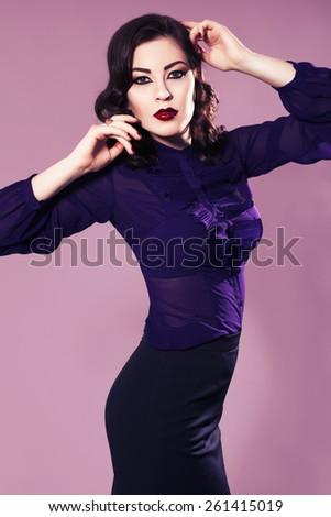 Beautiful brunette woman in dark skirt and blouse with evening make up and waves retro  hairstyle. fashion posing - stock photo