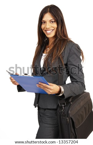 Beautiful brunette woman in pinstripe suit holding her clipboard. Isolated on white background with copy space - stock photo