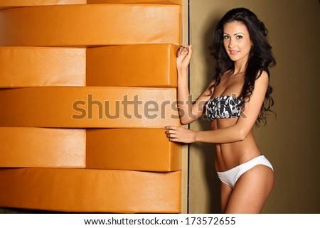 Beautiful brunette woman in swimwear - stock photo