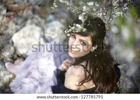 beautiful brunette woman in the park on a warm spring day