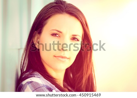 Beautiful brunette woman in the sun - stock photo