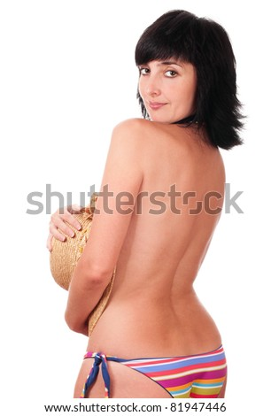 Beautiful brunette woman in topless bikini with hat in hand isolated on white - stock photo