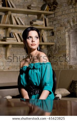 Beautiful brunette woman indoors - stock photo