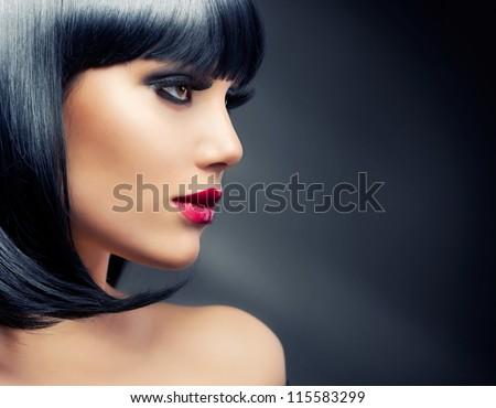 Beautiful Brunette Woman Portrait over Dark Background. Healthy Black Hair - stock photo