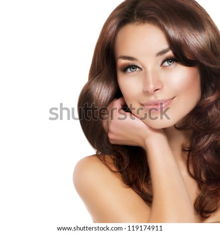 Beautiful Brunette Woman Portrait with healthy Hair.Clear Fresh Skin.Smiling Girl Isolated on a White Background.Skincare.Spa.Beauty Model