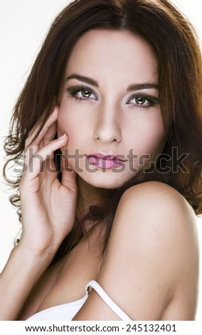 Beautiful Brunette Woman Portrait with healthy Hair.Clear Fresh Skin.Smiling Girl Isolated on a White Background - stock photo