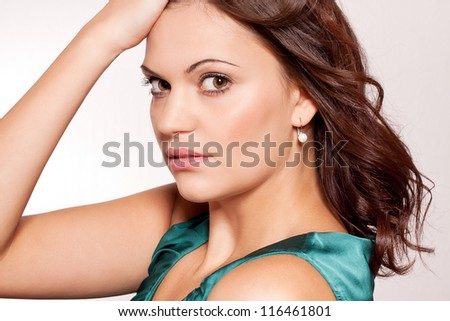 beautiful brunette woman portrait with makeup and brown eyes - stock photo
