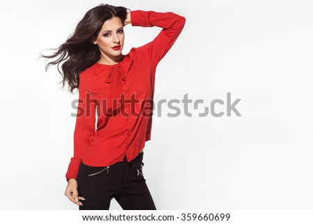 Beautiful brunette woman posing in red blouse, red lips, nice hair. Valentine's day photo - stock photo