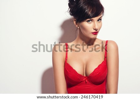 Beautiful brunette woman posing in red lingerie, bodysuit. Valentines day - stock photo