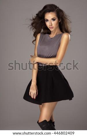 Beautiful brunette woman posing in studio   - stock photo