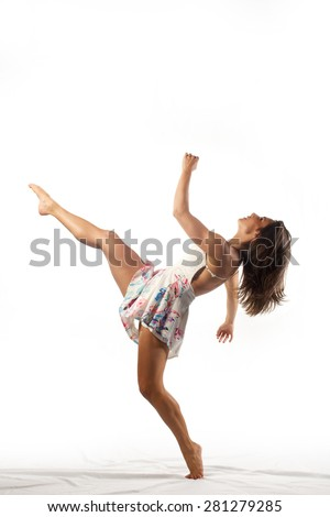beautiful brunette woman posing like dancer on white dress on white background  - stock photo