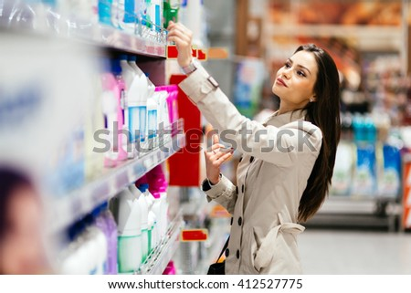 Beautiful  brunette woman shopping in supermarket - stock photo