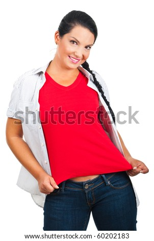 Beautiful brunette woman wearing a blank red t-shirt and showing to you isolated on white background - stock photo