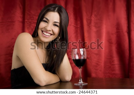 Beautiful brunette woman with a glass of wine - stock photo