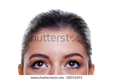Beautiful brunette woman with big brown eyes looking upwards, isolated on white background. - stock photo