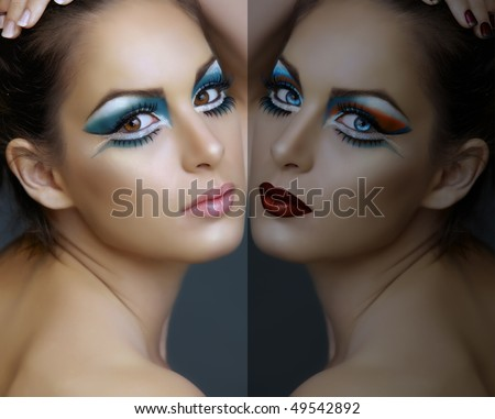 Beautiful brunette woman with cat eyes make-up in turquoise and white, with a double reflection - stock photo