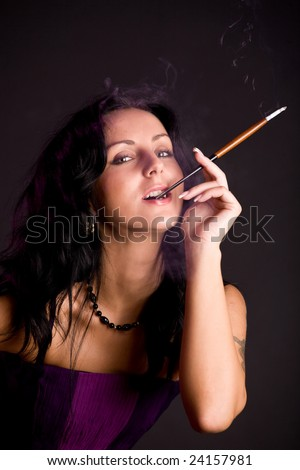 Beautiful brunette woman with cigarette