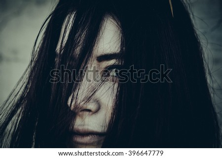 beautiful brunette  woman  with dark eyes  portrait