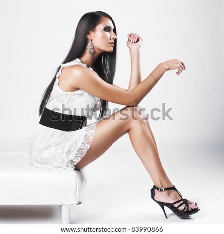 Beautiful brunette woman with elegant white dress. Fashion photo - stock photo
