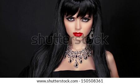Beautiful brunette woman with evening make-up. Jewelry and Beauty. Fashion photo - stock photo