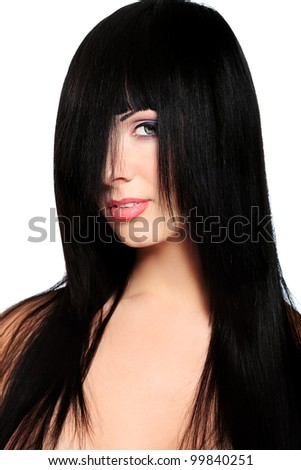 Beautiful brunette woman with hair on her face posing at studio. Isolated over white.